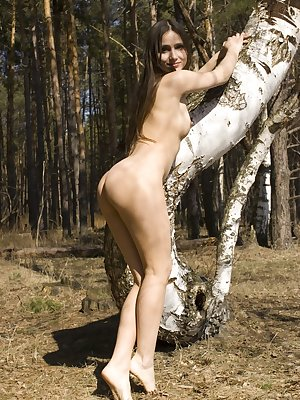 New model Tatielle showcasing her nubile body and intimate details as she poses sensually outdoors.