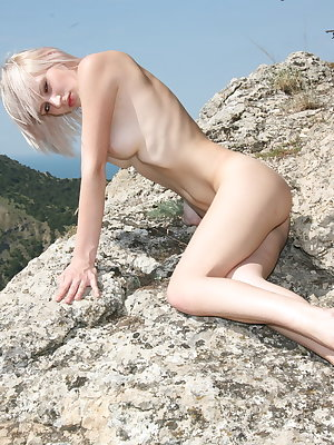 Val D, naked and uninhibited debuts on top of the rock overlooking a majestic view of the sea.