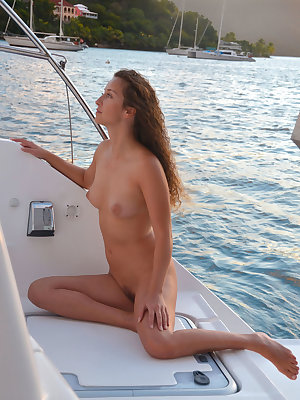 Sarka shows off her slender hot body as she delightfull poses sensually on the yacht.
