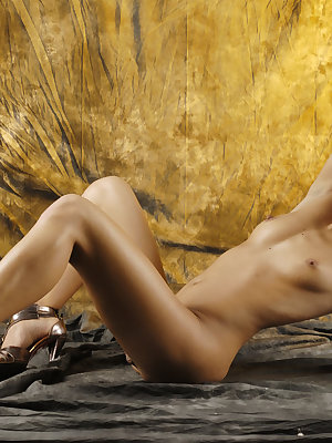 Dominika flaunts her sexy body then spreads her legs wide open baring her meaty labia.