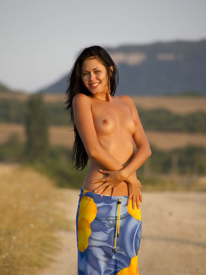 Jubia is ready for some fun today as she walks down the road topless and her bottom wrapped in a vibrant blue and bright yellow floral sarong.  Her gorgeous dark mane accentuates her beautiful features. She drops her sarong and flaunts her tanned, lithe b