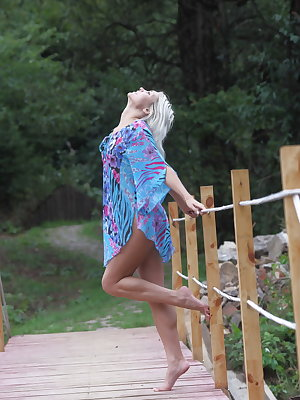 Kristy is a vibrant and captivating platinum blonde that commands your attention.  She poses playfully on the dock in her baby blue frock playing peek-a-boo pussy.  Indulge yourself and experience her svelte, toned body, small, perky breasts and enjoy her