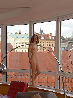 Sarka has nothing to hide as she poses naked in front of her open wall of windows.  Her poses are sexy, revealing and totally uninhibited. Her body lithe, toned and perfect! Discovering this little vixen in your neighborhood would definitely give you a vi
