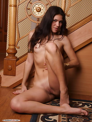 Alicia Cs hows off her slim and slender figure, beautiful puffy breasts by the stairs.