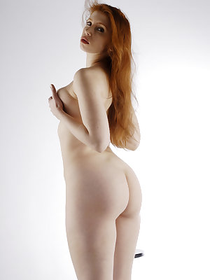 Alixia  is a stunning redhead with soft alabaster skin and beautiful full cherry lips.  Her round supple breasts accentuate her perfectly proportioned body and her fiery red bush complete the package.