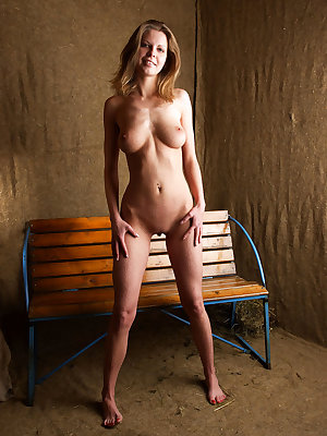 Olenk flaunts her gorgeous naked body and poses uninhibited on the bench.