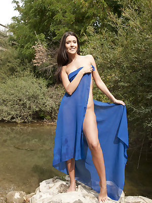 With just a sheer royal blue shawl to cover her fine luscious body, Mariy makes an enchanting presence by the river, posing naked without any hint of inhibition.