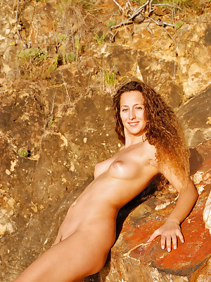 Sarka is a stunning long legged beauty that loves climbing amongst the rocks while working on her golden tan. Perfect puffy nipples to match her smooth pussy lips.