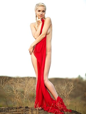 Alluring Aljena A draped in red silk. Watch as she unwraps her lovely lithe body exposing her small perky breasts and lovely round buttocks.
