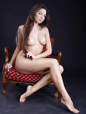 Gabrielle C loves posing on her retro red pattern chair. Look at her lovely toned legs and scrumptious buttocks.