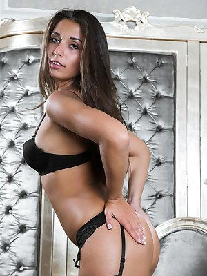 Nadele spreads herself open to reveal her hairy pussy and perfect ass in black lingerie.