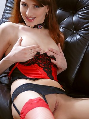 In seductive red and black lingerie, Kristine teases and pleases with her tight body.