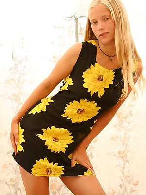 Luba B is sweet in her sunflower dress and shows off her hairy pussy.