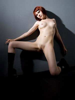 Sexy short-haired redhead, Anelie A, spreads herself for you to see in wide-open positions and showcases her smooth, lickable pussy.  Yummy!