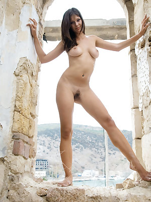 The brick ruins give a nice contrast to Nova's stunning allure, with her bright, vivacious smile, gorgeous flexible body and magnificent puffy breasts in her debut series.