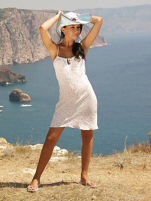 Margo makes an appealing debut as she strips her sexy dress and flaunts her great physique, and gorgeous puffy breasts over a refreshing ocean view.