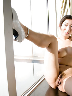 Ada flaunts her Asian assets, enticing us with her magnificent breasts, untrimmed bush, and sexy butt.