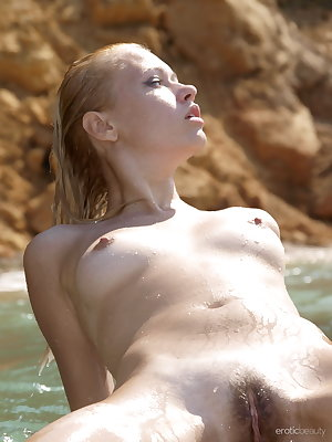 In a picturesque, rocky beach coast, Angie presents her natural, youthful beauty, her sultry, teasing look is so inviting to savor her nubile body with delightfully perky tits, and tight snatch.