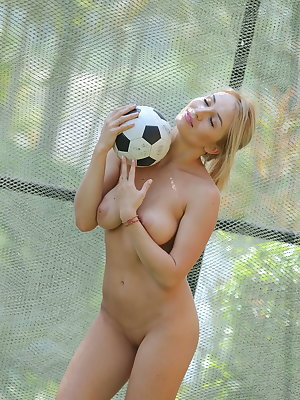 Busty Isabella D bares her luscious body as she plays football.