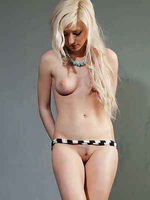 Gorgeous blonde Janelle B shows off her sweet pussy and puffy tits on the wet floor.