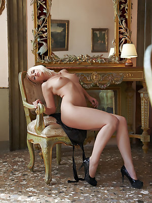 Colette flaunts her smoking hot body and yummy pussy on the chair.