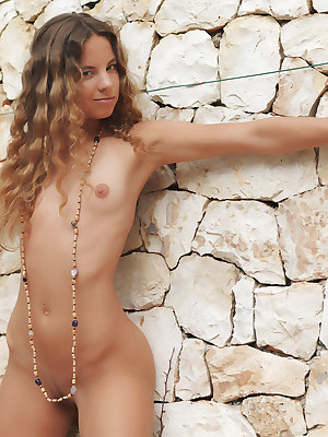 Antea sensually poses outdoors baring her petite body and sweet pussy.