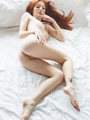 Sultry Micca shows off her delectable body with yummy pussy as she poses on the bed.
