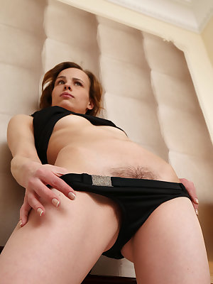 Liania strips her black lingerie baring her petite body with perky nipples and unshaven pussy on the bed.