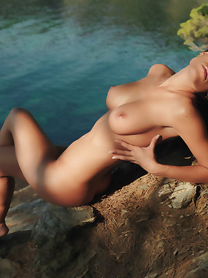 Nature girl Satin bares her smoking hot body by the river.