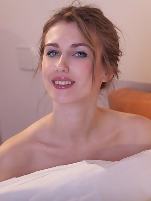 Arlett flaunts her smooth, creamy body with pink nipples and sweet pussy as she poses on the bed.