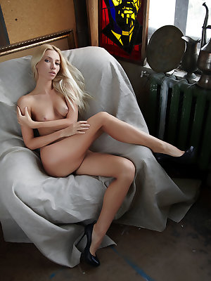 Adele shows off her sexy, slender body with long legs and yummy pussy as she poses with her black stilettos.