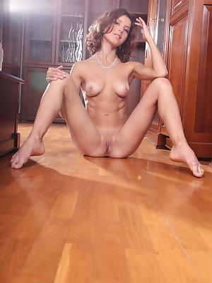Sati bares her sexy, athletic body and tight ass as she poses on the floor.