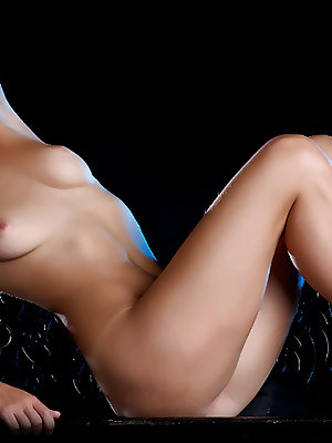 Top 10 model Belle loves showing off her awesome, slender body with puffy nipples and long, sexy legs.