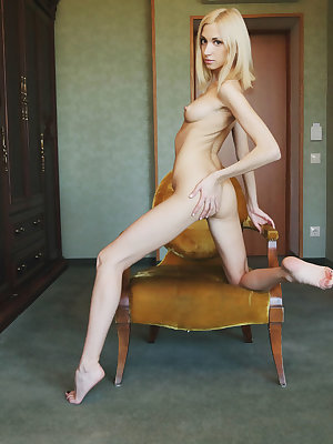 Anna Lee displays her lean and slender body with erect nipples, tight ass and yummy pussy on the chair.