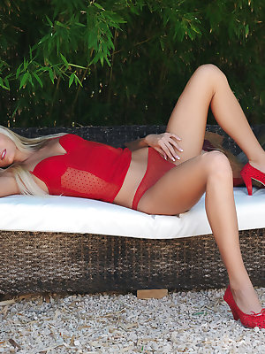 Paola strips her sexy red lingerie as she displays her smoking hot body, sexy legs and yummy pussy in the outdoors.