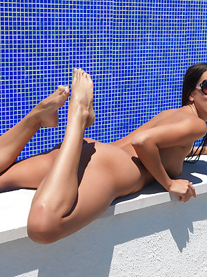 Tamaya confidently flaunts her smoking hot body with beautiful breasts and tight ass and delectble pussy by the pool.