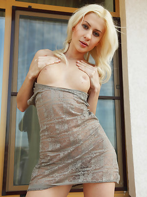 Beautiful blonde Viviene, performs an erotic strip tease in front of the camer, baring her yummy, unshaven pussy.