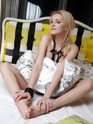 Adorable Oliana displays her magnificently athletic body and nubileb body all over the bed.