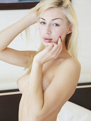 Jill looks seductive and sultry as she poses naked on her white sheets.  Her captivating blue eyes and blonde hair compliment her alabaster skin and perfectly proportioned body. Endulge in her suckable breasts and lickable smooth pussy.