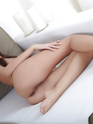 Afrodita shows off her young and petite body with smooth, pinkish bits, and her delectable tight pussy on the sofa.