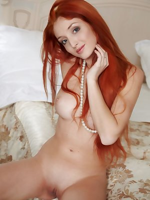 Micca is a hot redhead who loves showing off her silky meat curtains and perky tits.