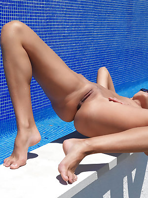 The bright blue water of the pool provides a cool contrast to Tamaya's stunning body with the amazing curvy waist and yummy round ass.