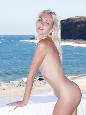 The azure sea and cloudless sky provides a stunning background to Cristina's petite and nubile body with small but perky breasts, a cute, firm butt, and sweet, tight snatch.