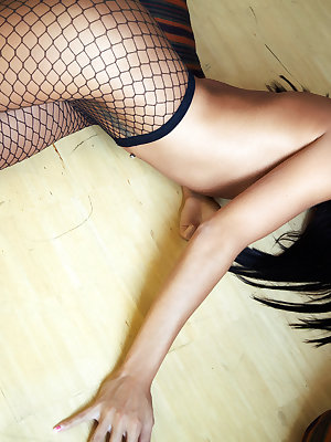 Jessie lounges in fishnet hose and high heels