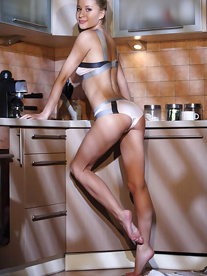 Candice B sensually strips in the kitchen ass she displays her yummy body.