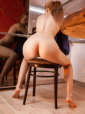 Shirley Tate strips in the kitchen baring her small pussy.