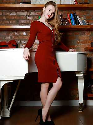 Newcomer Kate Chase displays her delectable, creamy body on the piano.