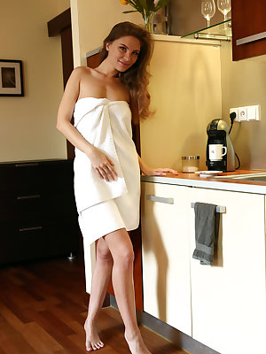 Galina A enjoys her morning with a cup of coffee before posing naked in the kitchen