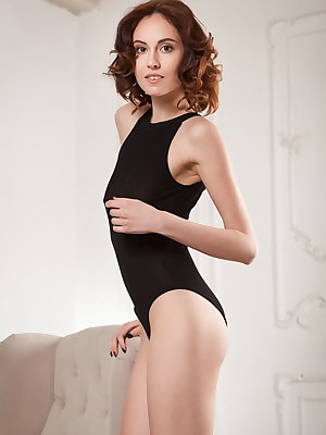 Ultra sexy Sade Mare in a black onepiece lingerie that compliments her long and lean body