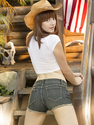 Cowgirl Lena Anderson bares her smoking hot body outdoors.